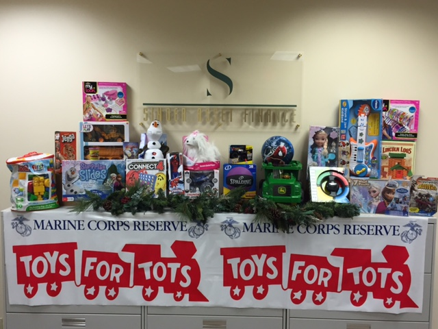 Toys For Tots Foundation : Singer asset finance company shows holiday spirit by